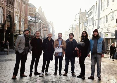 From left to right, Busker Paul Adrian, Production Manager Mike Smith, Producer Mark Trifunovic, Director Mark Trifunovic, Digital Colourist Ben Saffer, Sound Recordist Rob Wingfield, Busker Steven Lockmoore.